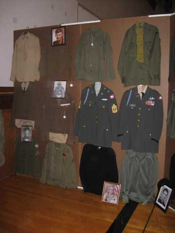 Navy, Marine Corps, and Air Force uniforms from the Korean War era.